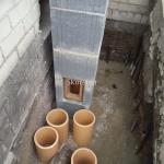 Kaminas iš blokelių ir keraminiai vamzdžiai
